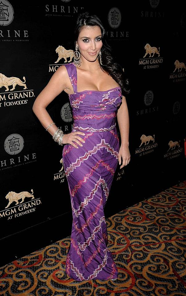 "Reality vixen Kim Kardashian flaunts her famous curves in a purple print dress at Shrine nightclub. The event is part of the grand opening weekend celebration for the MGM Grand at the Foxwoods Resort and Casino in Connecticut. Dimitrios Kambouris/<a href=""http://www.wireimage.com"" target=""new"">WireImage.com</a> - May 17, 2008"