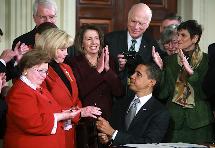 Lilly Ledbetter receives a pen from President Barack Obama after he signed the Lilly Ledbetter Fair Pay Act in 2009, two years after Justice Ruth Bader Ginsburg urged Congress to fix what she said was the Supreme Court's mistake.