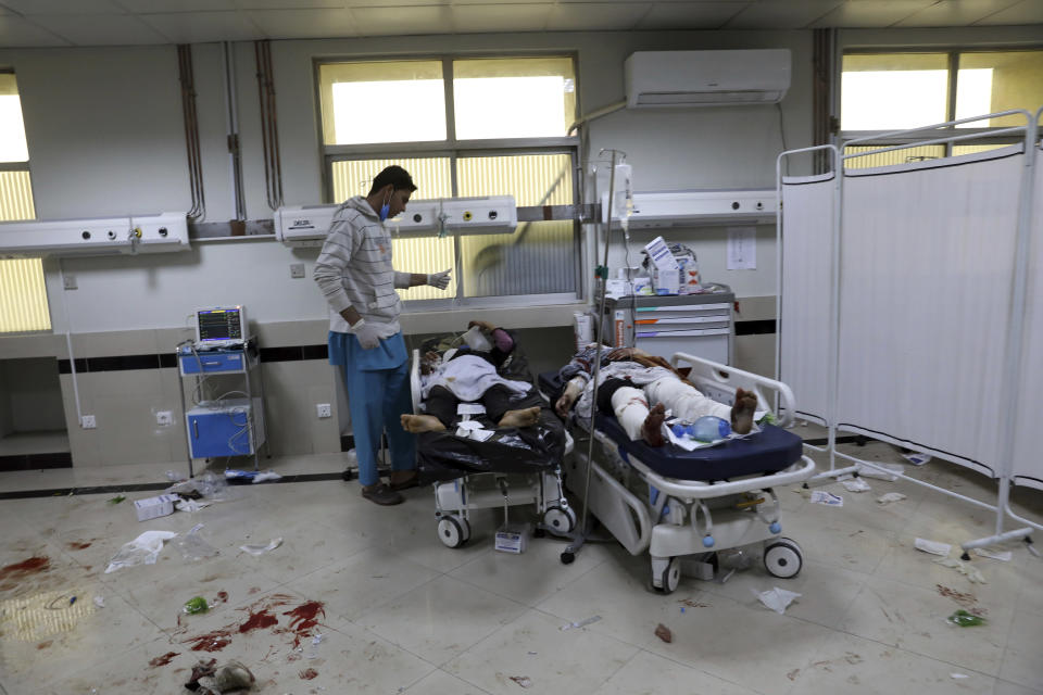 Afghan school students are treated at a hospital after a bomb explosion near a school in west of Kabul, Afghanistan, Saturday, May 8, 2021. A bomb exploded near a school in west Kabul on Saturday, killing several people, many them young students, an Afghan government spokesmen said. (AP Photo/Rahmat Gul)