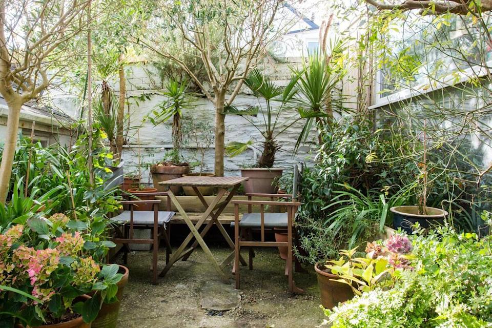 """<p>For an Airbnb in Cornwall that's gorgeous both inside and out, look no further than this stunning bolthole in Falmouth. It's arty, pretty and just delightful. The flat has been beautifully designed with relaxation in mind so that you feel zen before even stepping inside.</p><p>From the soft linens on the comfy bed to the artwork and seriously chic use of colour throughout, this is an Airbnb that offers a touch of country life close to the beach.</p><p><strong>Sleeps</strong>: 2</p><p><strong>Price per night:</strong> £103</p><p><strong>Why we love it:</strong> The thoughtful design and little touches, like the olive trees in the courtyard garden creating a mini oasis.</p><p><a class=""""link rapid-noclick-resp"""" href=""""https://www.airbnb.co.uk/rooms/plus/10403069?source_impression_id=p3_1592404574_LsEG8NPNGUEnUEGj&guests=1&adults=1"""" rel=""""nofollow noopener"""" target=""""_blank"""" data-ylk=""""slk:SEE INSIDE"""">SEE INSIDE</a></p>"""