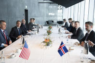 Icelandic Foreign Minister Gudlaugur Thor Thordarson, second right, sits opposite US Secretary of State Antony Blinken, second left, during a at the Harpa Concert Hall in Reykjavik, Iceland, Tuesday, May 18, 2021. Blinken is touting the Biden administration's abrupt shift in its predecessor's climate policies as he visits Iceland for talks with senior officials from the world's Arctic nations. (Saul Loeb/Pool Photo via AP)