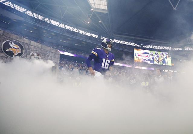 Minnesota Vikings quarterback Matt Cassel runs onto the field before the NFL football game against the Pittsburgh Steelers at Wembley Stadium, London, Sunday,Sept. 29, 2013. (AP Photo/Matt Dunham)