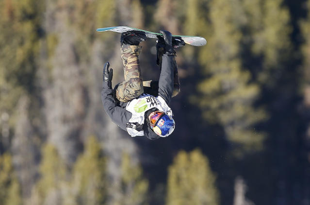 Canada's Mark McMorris flips off a jump during the slopestyle snowboarding final at the Dew Tour iON Mountain Championships, Sunday, Dec. 15, 2013, in Breckenridge, Colo. (AP Photo/Julie Jacobson)