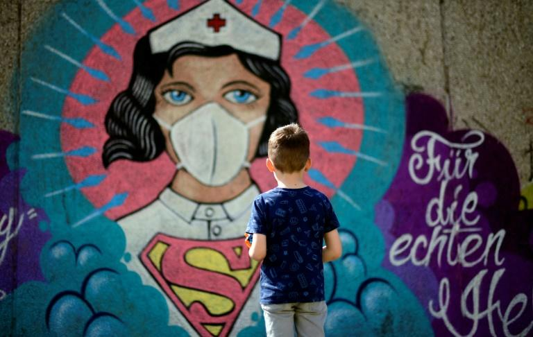 Nurses and doctors have been applauded across the globe as heroes (AFP Photo/Ina FASSBENDER)