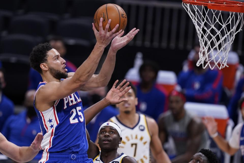 Philadelphia 76ers' Ben Simmons (25) shoots during the first half of an NBA basketball game against the Indiana Pacers, Friday, Dec. 18, 2020, in Indianapolis. (AP Photo/Darron Cummings)