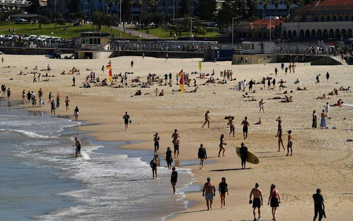 People walk at Bondi Beach, as more than 80 per cent of New South Wales remains in strict lockdown as the state struggles to bring a Covid surge under control, in Sydney, Australia on 11 August 2021 - Joel Carrett/Shutterstock