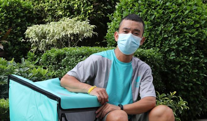 Samuel Hau, who is working as part of the Deliveroo team, poses for a picture in Yuen Long. Photo: Edmond So
