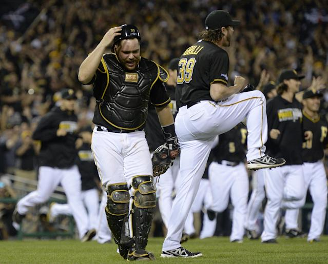 Pittsburgh Pirates catcher Russell Martin, left, and Pittsburgh Pirates relief pitcher Jason Grilli (39) celebrate after getting the last out in the ninth inning of the NL wild-card playoff baseball game against the Cincinnati Reds on Tuesday, Oct. 1, 2013, in Pittsburgh. The Pirates won 6-2 and advance to the National League Division Series.(AP Photo/Don Wright)