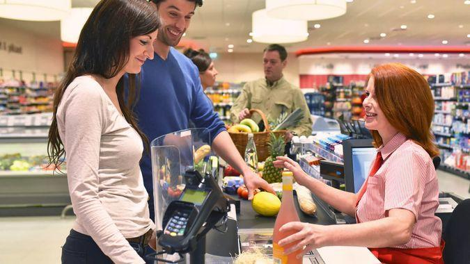 people shopping for food in the supermarket.