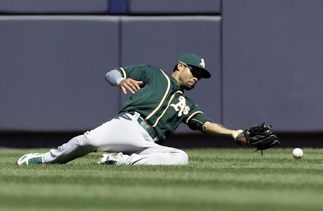 Oakland Athletics center fielder Coco Crisp drops a ball hit by New York Yankees' Alfonso Soriano allowing a double during the seventh inning of a baseball game Thursday, June 5, 2014, in New York. (AP Photo/Frank Franklin II)