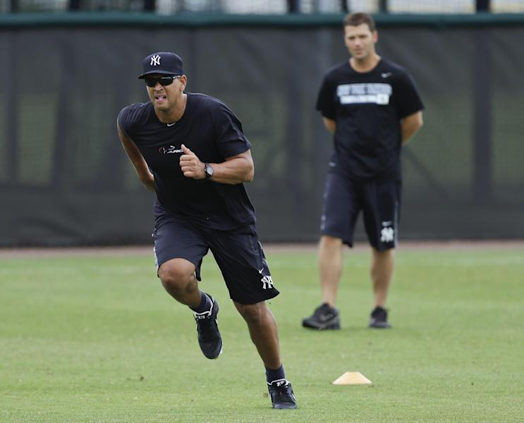 New York Yankees third baseman Alex Rodriguez runs under the supervision of trainer Mike Wickland during a workout Wednesday, June 5, 2013, at the Yankees' minor league complex in Tampa, Fla. (AP Photo/Chris O'Meara)