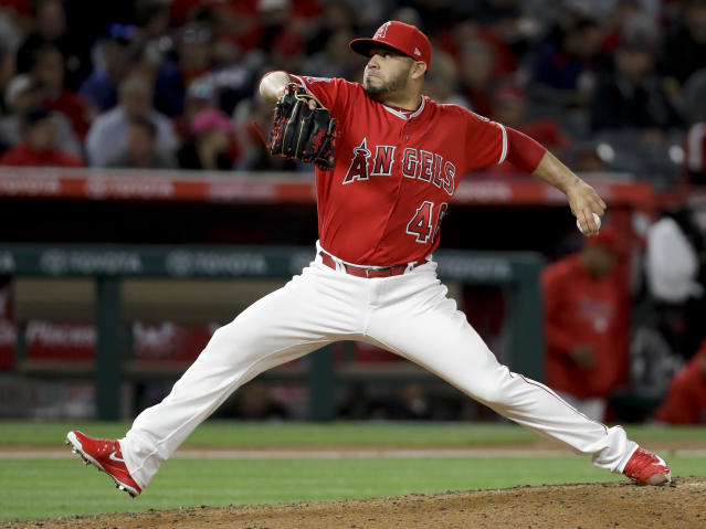FILE - In this April 18, 2018, file photo, Los Angeles Angels relief pitcher Jose Alvarez throws to a Boston Red Sox batter during the fifth inning of a baseball game in Anaheim, Calif. The Philadelphia Phillies have acquired Alvarez from the Angels for right-hander Luis Garcia. (AP Photo/Chris Carlson, File)