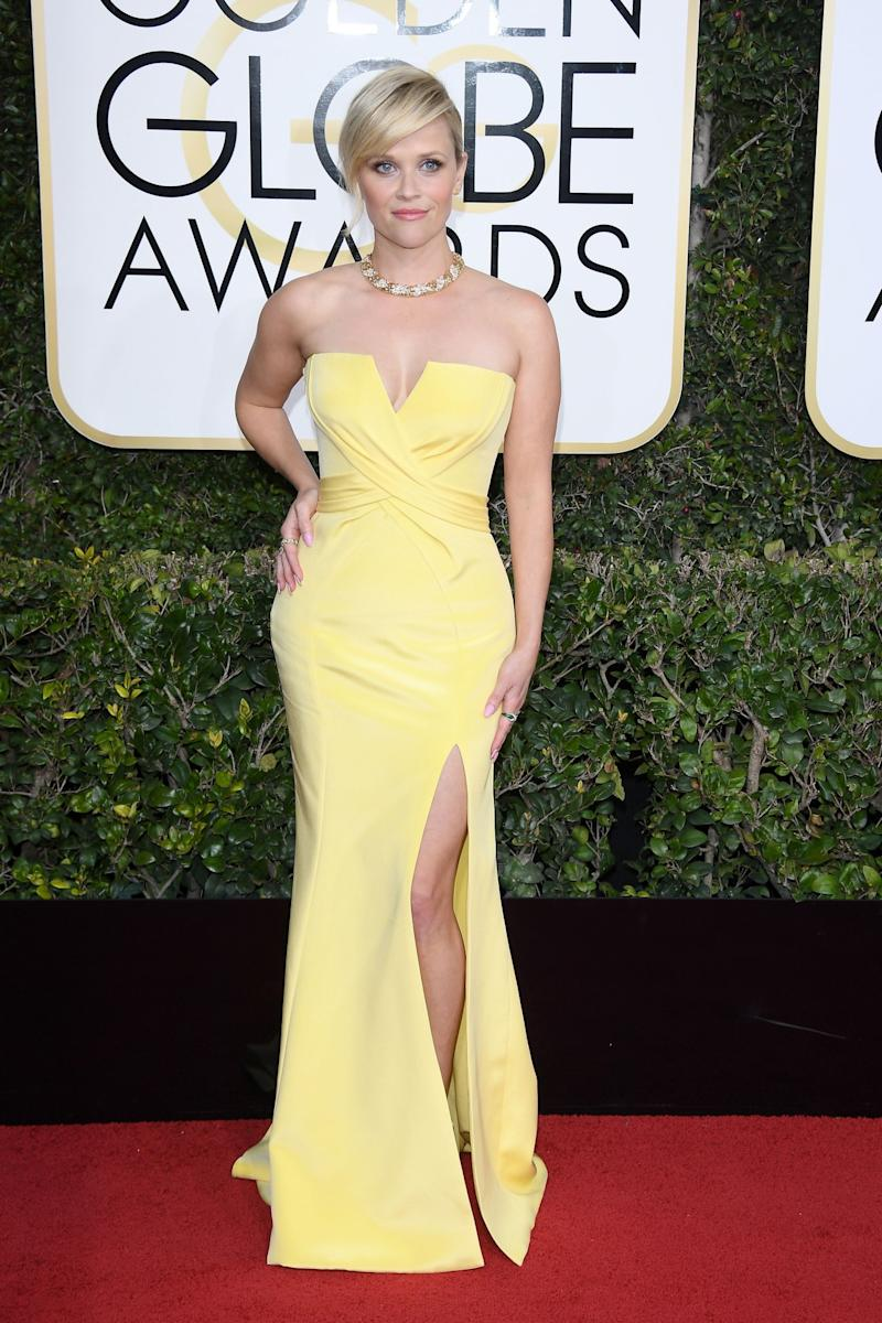The actress wore yellow to the 74th Annual Golden Globe Awards. (Photo: Getty Images)