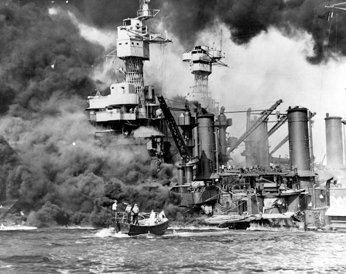 <p>Sailors in a motor launch rescue a survivor from the water alongside the sunken battleship USS West Virginia during or shortly after the Japanese air raid on Pearl Harbor on Dec. 7, 1941. (U.S. Navy/National Archives/Handout via Reuters) </p>