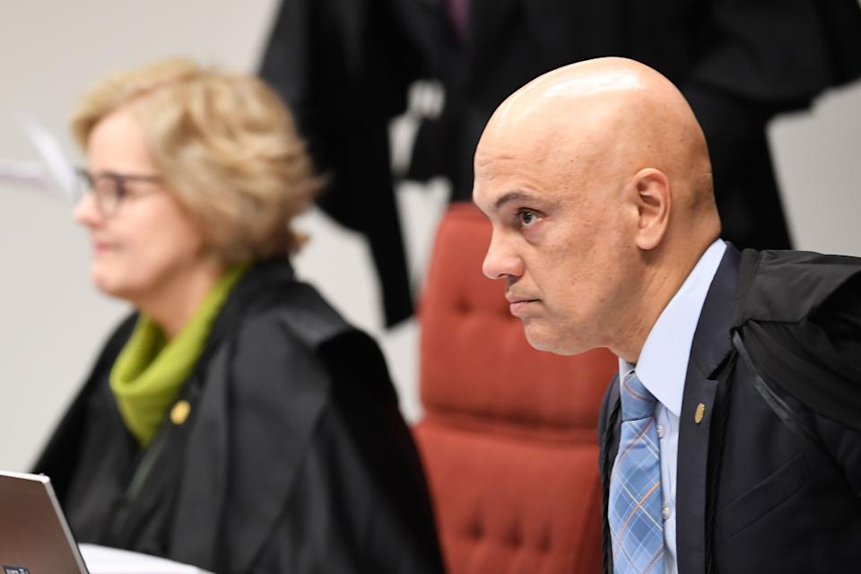 Brazilian Judge Alexandre de Moraes (R) attends a session of the Federal Supreme Court on June 20, 2017 in Brasilia. The court is considering a new arrest warrant against secluded senator Aecio Neves of the Brazilian Social Democracy Party (PSDB), who is accused of having received bribes from the owners of meat processing global giant JBS. / AFP PHOTO / EVARISTO SA        (Photo credit should read EVARISTO SA/AFP via Getty Images)