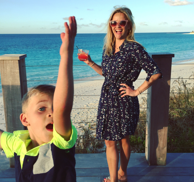 "<p>Witherspoon and her 5-year-old son, Tennessee, shared the ""<a href=""https://www.instagram.com/p/BhT7gWcHEL1/?taken-by=reesewitherspoon"" rel=""nofollow noopener"" target=""_blank"" data-ylk=""slk:last day of Spring Break"" class=""link rapid-noclick-resp"">last day of Spring Break</a>"" together. While she didn't have a swimsuit, she did have a very pretty view, a cocktail in her hand, and a cutie by her side. (Photo: Reese Witherspoon via Instagram) </p>"