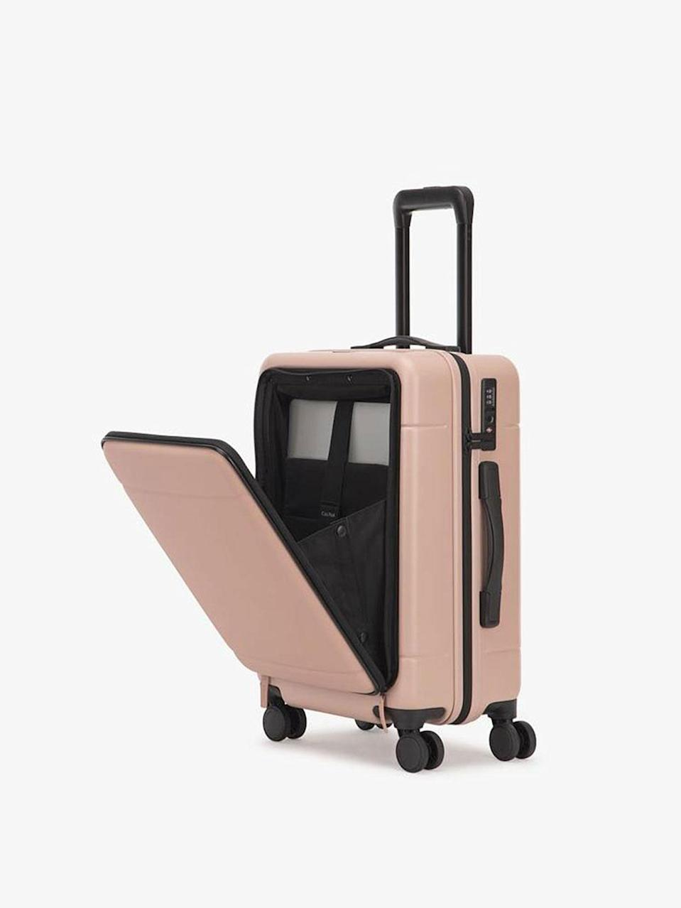 <p>This adorable tiny carry-on has multiple compartments to compactly fit all your shoes, accessories, and outfit changes. There's even a laptop sleeve in the front pocket, so you don't have to worry about carrying a separate work bag. The lock is also TSA-approved, meaning your valuables will no doubt stay safe.</p>