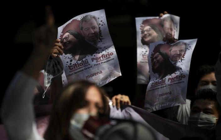 Supporters of Porfirio Munoz Ledo hold up posters of him outside Morena party headquarters, amid elections to select the party's leader in Mexico City, Monday, Oct. 12, 2020. The ruling party is making its third try at electing a party leader. (AP Photo/Fernando Llano)