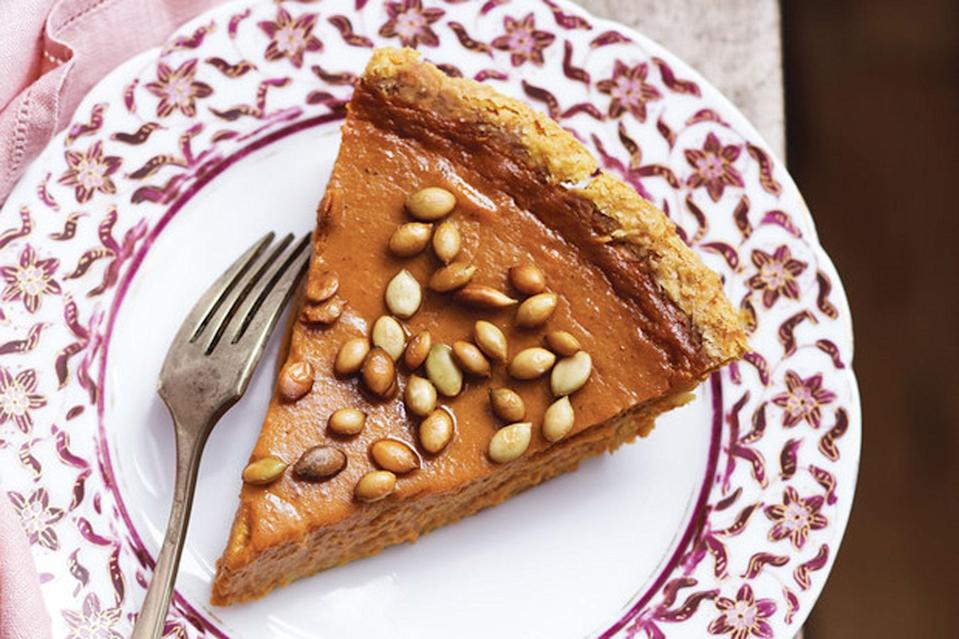 """A cornmeal crust and salty, crunchy pumpkin seeds on top make for an extra-special pumpkin pie. <a href=""""https://www.epicurious.com/recipes/food/views/fresh-pumpkin-pie-with-salty-roasted-pepitas-388669?mbid=synd_yahoo_rss"""" rel=""""nofollow noopener"""" target=""""_blank"""" data-ylk=""""slk:See recipe."""" class=""""link rapid-noclick-resp"""">See recipe.</a>"""