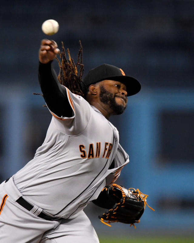 San Francisco Giants starting pitcher Johnny Cueto throws to the plate during the first inning of a baseball game against the Los Angeles Dodgers Friday, March 30, 2018, in Los Angeles. (AP Photo/Mark J. Terrill)