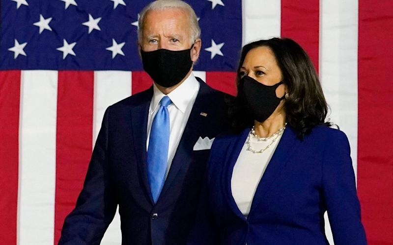 Democratic presidential candidate former Vice President Joe Biden and his running mate Sen. Kamala Harris, D-Calif., arrive to speak at a news conference at Alexis Dupont High School in Wilmington, Delaware, on Wednesday 12th August - AP