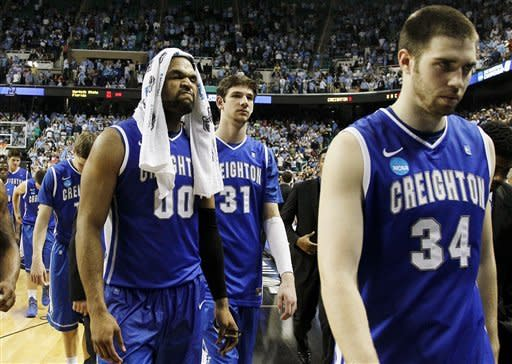 Creighton's Gregory Echenique (0), Will Artino (31) and Ethan Wragge (34) leave the court following an 87-73 loss to North Carolina in an NCAA tournament third-round college basketball game in Greensboro, N.C., Sunday, March 18, 2012. (AP Photo/Gerry Broome)