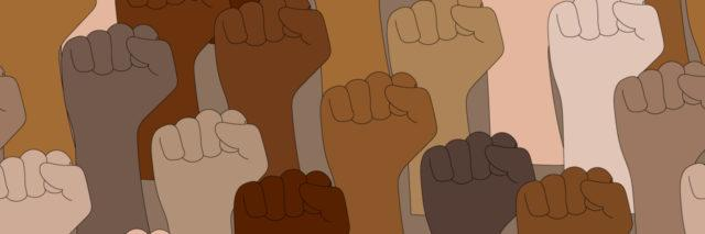 Seamless pattern of raised arms with clenched fists of different skin colors. Protests against racism