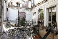 Bits of rubble inside an abandoned 19th century manor. The small farming village survived the Great War and German occupation in World War Two, but the noise from the Charles de Gualle airport was too much for its residents to bear. (Reuters)