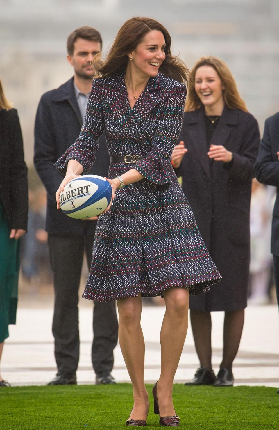 <p>When in Paris, why not wear multiple Chanel pieces? For her last day in the French capital, the Duchess wore a tweed coat dress by the Parisian brand with a Chanel logo belt and quilted burgundy bag. Chanel shoes weren't on the menu for Kate chose her trusty fringed leather pumps by Tod's.<br><i>[Photo: PA]</i> </p>