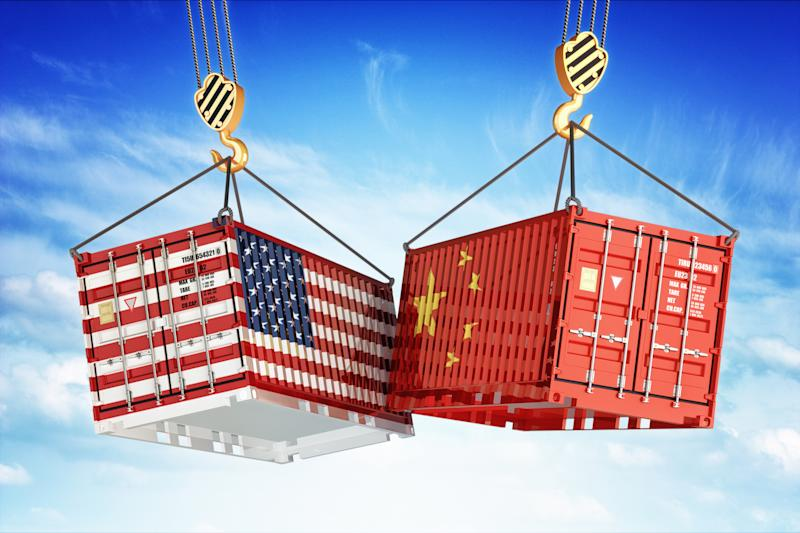 A cargo crate with the U.S. flag painted on it crashes into a crate painted in the Chinese flag.