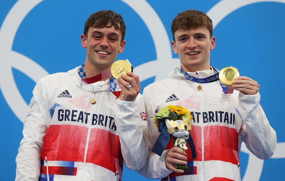 TOKYO, JAPAN - JULY 26: Matty Lee and Thomas Daley of Team Great Britain pose with their gold medals during the medal presentation for the Men's Synchronised 10m Platform Final on day three of the Tokyo 2020 Olympic Games at Tokyo Aquatics Centre on July 26, 2021 in Tokyo, Japan. (Photo by Clive Rose/Getty Images)