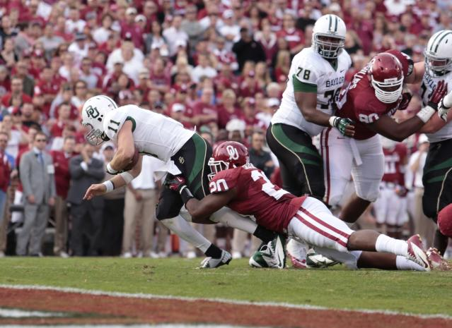 NORMAN, OK - NOVEMBER 10: Quarterback Nick Florence #11 of the Baylor Bears is tackled by linebacker Frank Shannon #20 of the Oklahoma Sooners November 10, 2012 at Gaylord Family-Oklahoma Memorial Stadium in Norman, Oklahoma. (Photo by Brett Deering/Getty Images)
