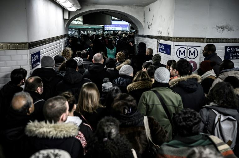 Commuters on the Paris metro faced another day of travel havoc Thursday as unions pressed their strike against a planned pension reform