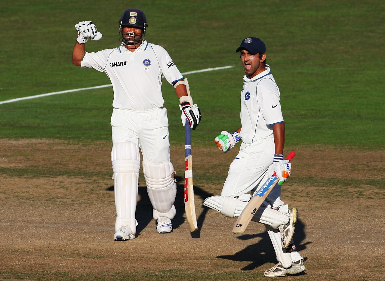 NAPIER, NEW ZEALAND - MARCH 29:  Gautam Gambhir of India (R) celebrates his century with Sachin Tendulkar (L) during day four of the second test match between New Zealand and India at McLean Park on March 29, 2009 in Napier, New Zealand.  (Photo by Phil Walter/Getty Images)