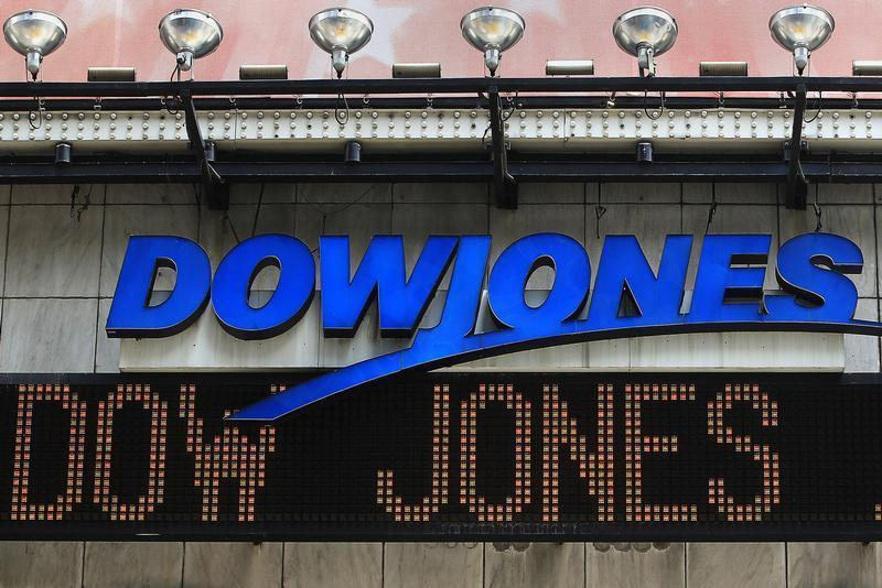 The Dow Jones financial electronic ticker is seen at Times Square in New York