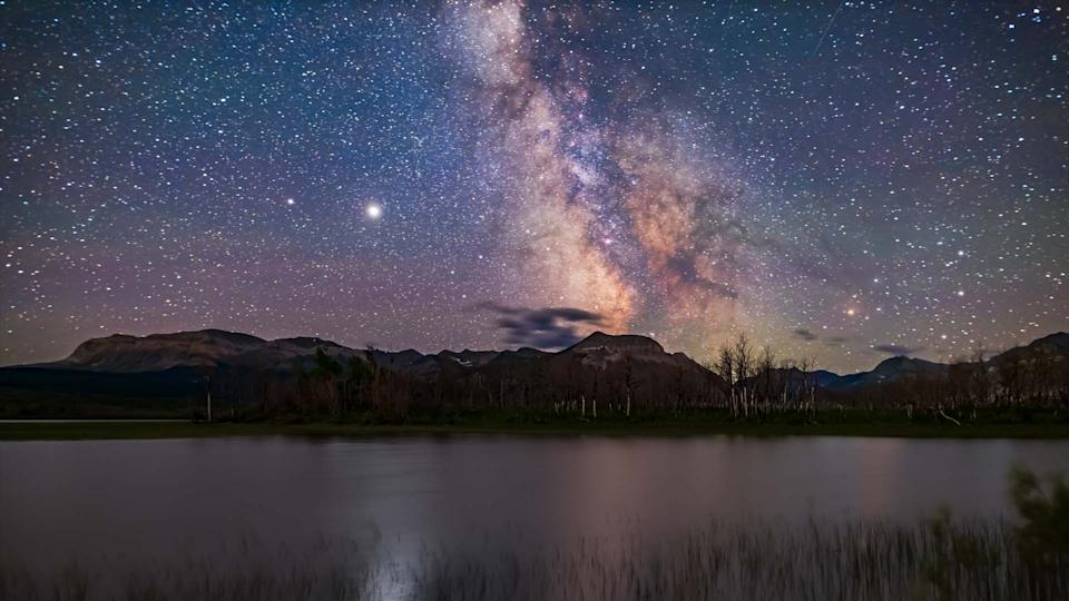 Jupiter & Saturn appear over Maskinonge Pond in Waterton Lakes National Park, Alberta. (Photo: Getty Images)