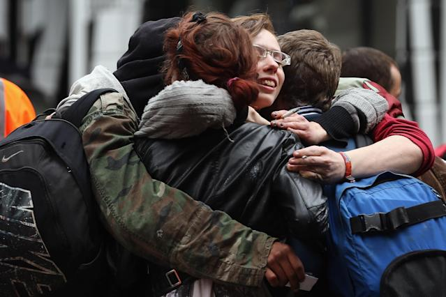 LONDON, ENGLAND - JUNE 11: Protesters console each other after being led from a building they had been occupying on Beak Street in Soho, as part of a protest ahead of next week's G8 summit in Northern Ireland on June 11, 2013 in London, England. Next week will see Enniskillen in Northern Ireland host the two day G8 summit where international leaders including Britain's Prime Minister David Cameron and US President Barack Obama take part in the two day event. The chosen location is only 8 kilometers from the scene of one of Northern Ireland's worst killings back in 1987, however Cameron is confident that it's secluded location will deter any potential trouble. (Photo by Dan Kitwood/Getty Images)