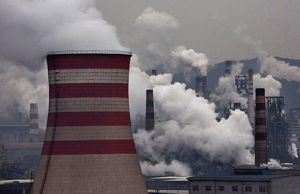 Smoke billows from smokestacks and a coal fired generator at a steel factory on November 19, 2015 in the industrial province of Hebei, China (Getty Images)