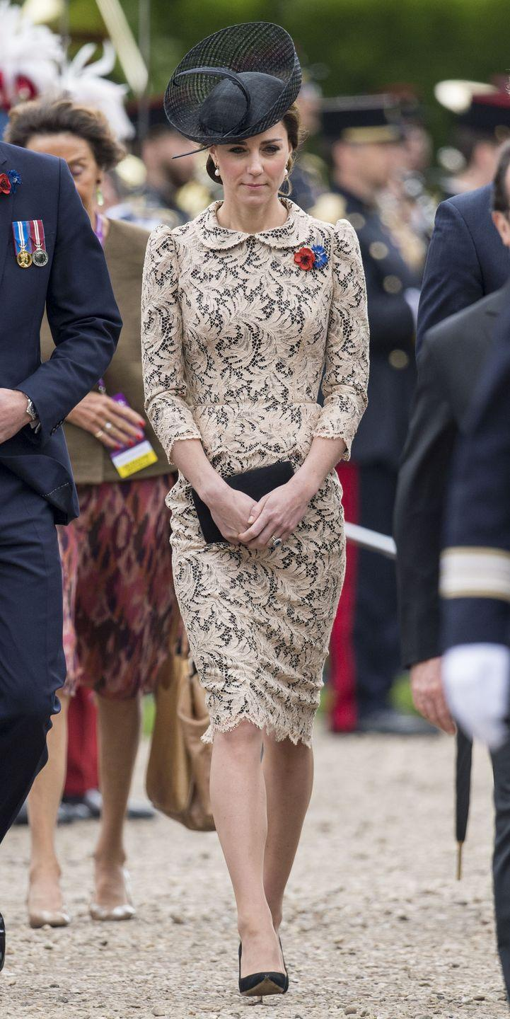 <p>Kate Middleton wears a white lace peplum dress with a scalloped hem, a hat by Lock & Co, black clutch and black pumps at the Somme Centenary Commemorations in France.</p>