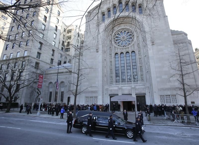 Police walk with the hearse containing the body of former New York City Mayor Ed Koch as it arrives at Temple Emanu-El for his funeral in New York, Monday, Feb. 4, 2013. Koch died Friday of congestive heart failure at age 88. (AP Photo/Seth Wenig)
