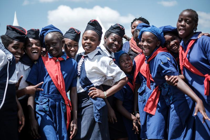 Members of Kenya Girl Guides take photos after attending a ceremonyto mark International Women's Day.