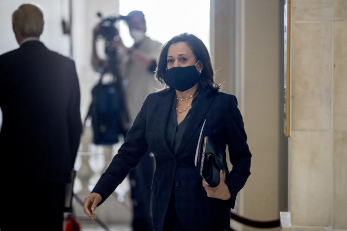 Sen. Kamala Harris, D-Calif., arrives as the Senate Homeland Security and Governmental Affairs committee meets on Capitol Hill in Washington, Wednesday, May 20, 2020, to issue a subpoena to Blue Star Strategies. (AP Photo/Andrew Harnik)