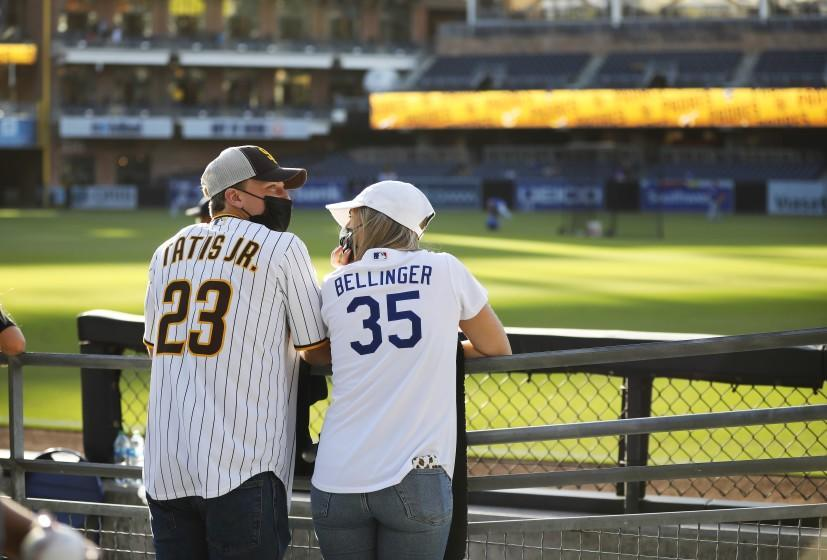 SAN DIEGO, CA - APRIL 16: Ethan Cloutier, and his girlfriend Caelan Gianni watch batting practice.