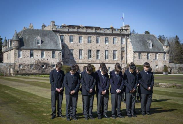 Pupils at the Duke of Edinburgh's former school, Gordonstoun in Moray, observe the one-minute silence on the day of his funeral
