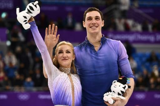 <p>Record-setters Savchenko and Massot win emotional skating gold</p>