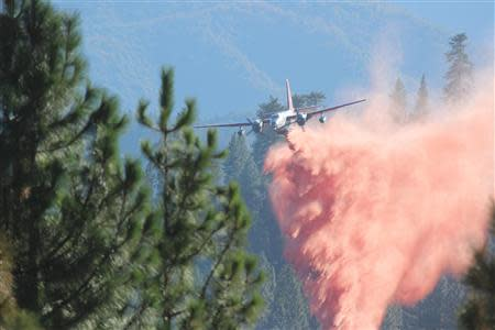 U.S. Forest Service handout photo shows a tanker dropping retardant on the Rim Fire near Yosemite National Park in California