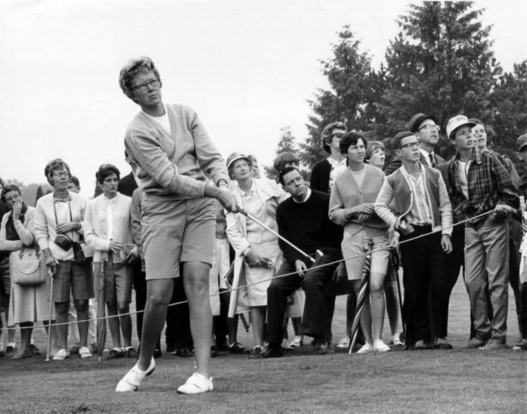 FILE - In this  1967 file photo, the gallery follows Mickey Wright's iron shot from the fairway at the Toronto Golf Club. Hall of Fame golfer Wright, who won 82 LPGA tournaments including 13 majors, died Monday, Feb. 17, 2020, of a heart attack, her attorney said. Wright was 85. (AP Photo, File)