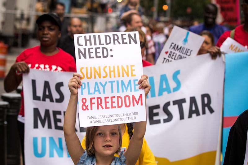 Demonstrators protest against the Trump administration's immigration policies, which resulted in more than 2,500 children being separated from their parents. (Drew Angerer via Getty Images)