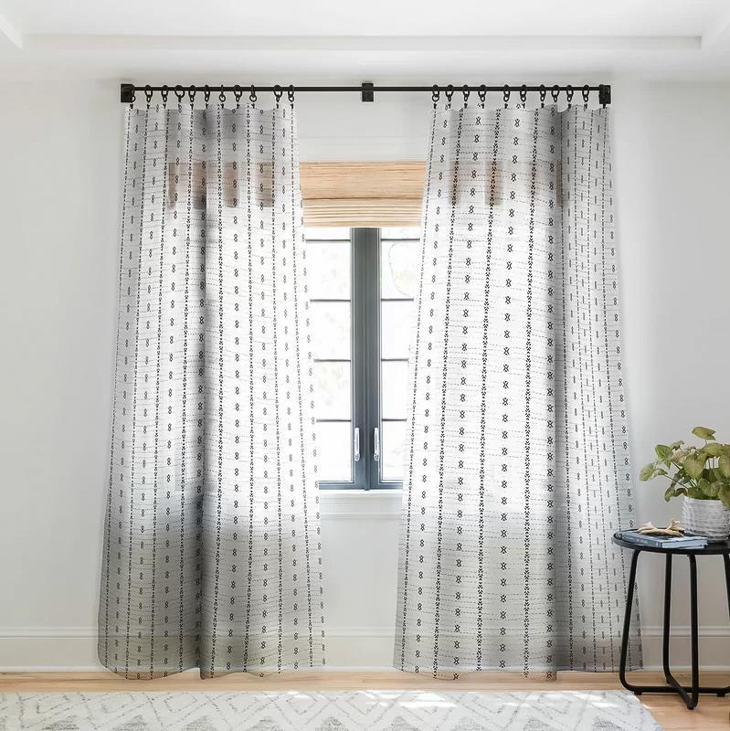 """<p>These black-and-white curtains are lined with a vertical pattern that's subtle, not distracting.</p> <p><strong><em>Shop Now:</em> </strong><em>Holli Zollinger Tribal Sheer Pinch Pleat Curtain Panels, $76.99, <a href=""""http://www.anrdoezrs.net/links/7799179/type/dlg/sid/MSL,TheBestSimpleLinenCurtainsforYourNeutralHome,dlarson,Cur,Gal,7838948,202006,I/https://www.wayfair.com/decor-pillows/pdp/east-urban-home-holli-zollinger-tribal-sheer-pinch-pleat-single-curtain-panel-etrb6472.html?piid="""" rel=""""nofollow noopener"""" target=""""_blank"""" data-ylk=""""slk:wayfair.com"""" class=""""link rapid-noclick-resp"""">wayfair.com</a></em><em>. </em></p>"""