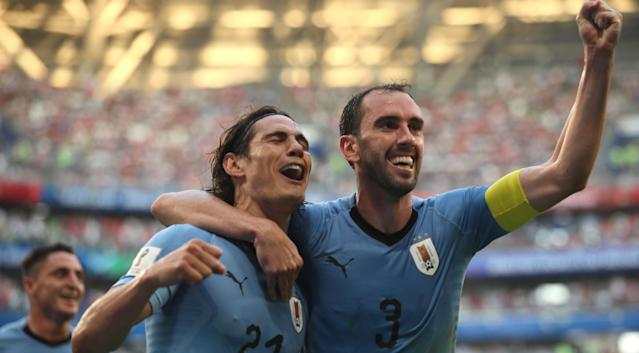 Samara (Russian Federation), 25/06/2018.- Edinson Cavani (C) of Uruguay celebrates scoring the 3-0 lead with teammate Diego Godin during the FIFA World Cup 2018 group A preliminary round soccer match between Uruguay and Russia in Samara, Russia, 25 June 2018. (RESTRICTIONS APPLY: Editorial Use Only, not used in association with any commercial entity - Images must not be used in any form of alert service or push service of any kind including via mobile alert services, downloads to mobile devices or MMS messaging - Images must appear as still images and must not emulate match action video footage - No alteration is made to, and no text or image is superimposed over, any published image which: (a) intentionally obscures or removes a sponsor identification image; or (b) adds or overlays the commercial identification of any third party which is not officially associated with the FIFA World Cup) (Mundial de Fútbol, Rusia) EFE/EPA/WALLACE WOON EDITORIAL USE ONLY